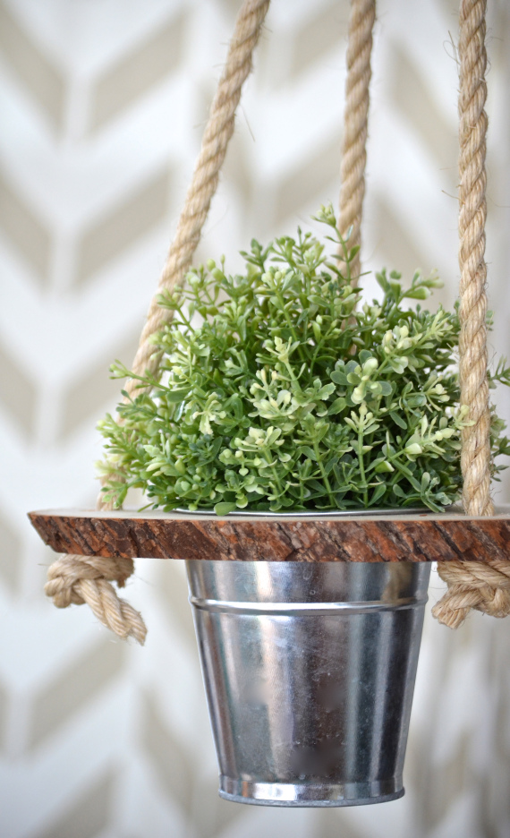 A wood slice, a pot and rope is all you need.